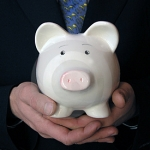 piggy bank in hands for HIgh Deductable Health Plans
