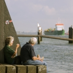 older couple sitting on pier for Whole Life Insurance
